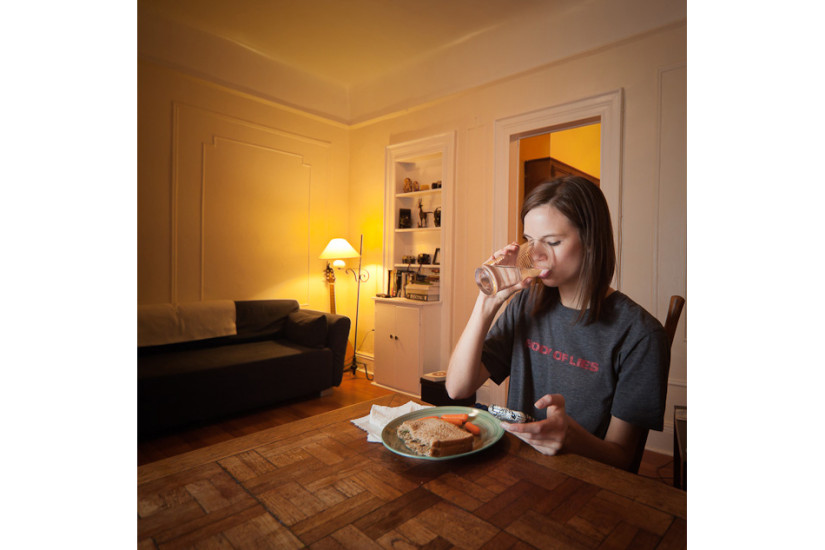 Chelsea Olson, a model concentrates on her food while reviewing her busy day. Age: 20   Time: 8:13 PM   Location: Windsor Terrace, Brooklyn