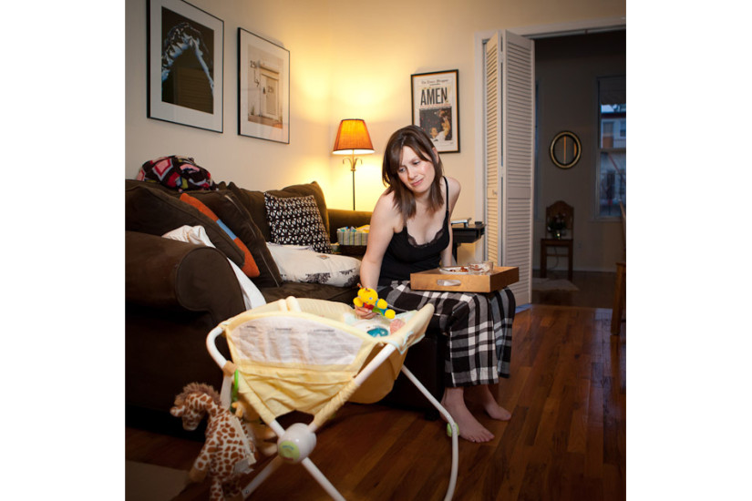 Kristy May has quick dinner, dandling her 1 month newborn baby. Age: 32  Time: 4:50 PM  Location: Greenpoint, Brooklyn