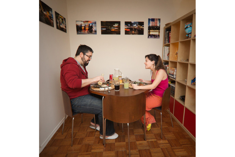 Giselle Behrens and Fernando Mendoza, wife and husband both from Venezuela enjoy one another's company over a home-cooked meal prepared by Fernando. Age: Giselle 26, Fernando 27   Time: 9:30 PM   Location: Midtown West, New York