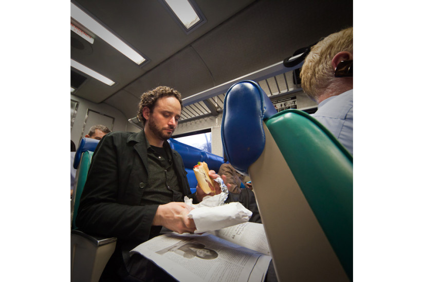 Matthew, relaxes with a sandwich and a beer during the evening commute to Pleasantville, NY. Age: 30  Time: 6:59 PM    Location: White Plains, Harlem Line